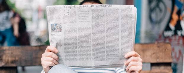 Collecteweek promoten - man met krant